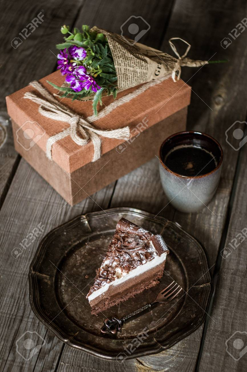 Chocolate Birthday Cake With Flowers Cup Of Coffee And Present