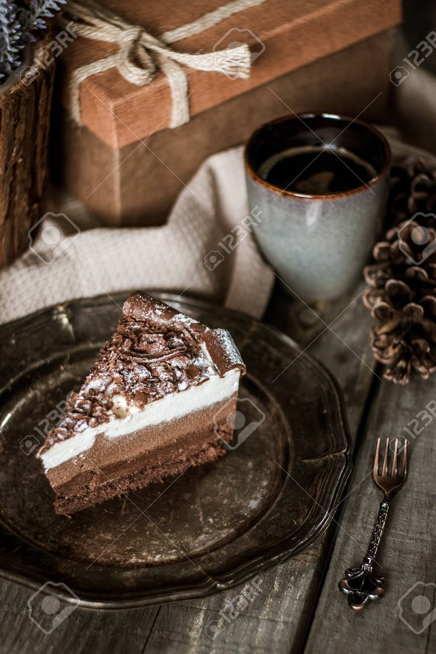 Chocolate Birthday Cake With Flowers Cup Of Coffee And Present Box On A Wooden Table