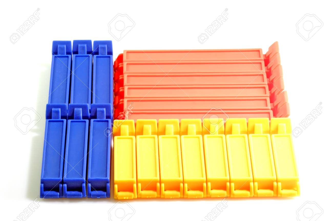Red blue and yellow kitchen clips on bright background Stock Photo - 2702311