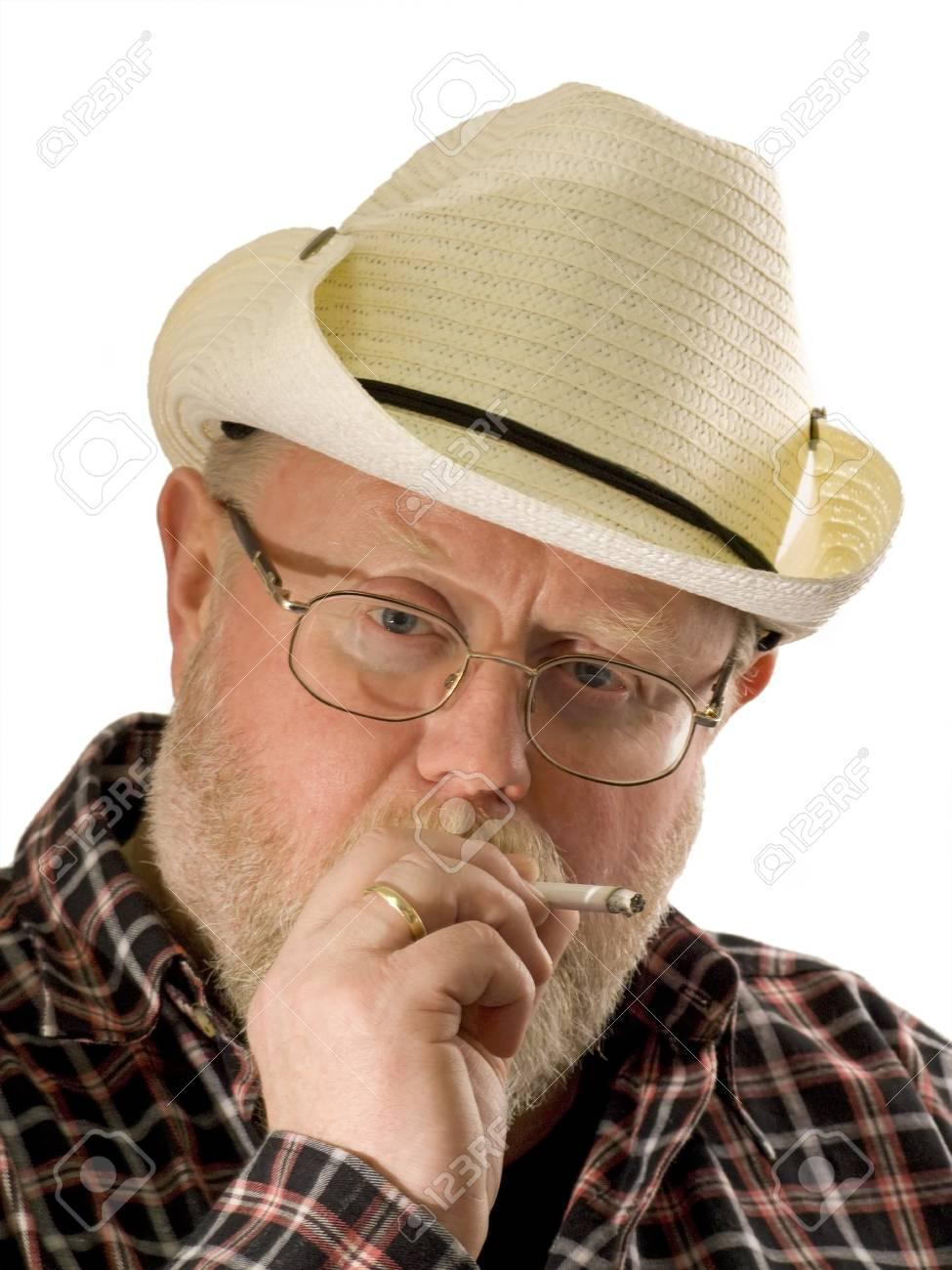 Smoking man on white background. Shot in studio. Stock Photo - 4325390