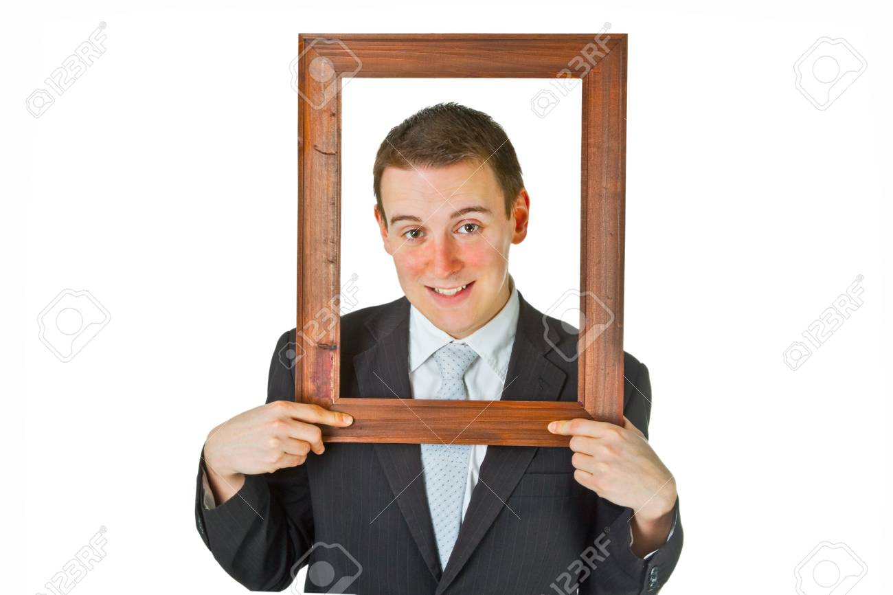 Friendly businessman with wooden frame isolated on white background Stock Photo - 9210867