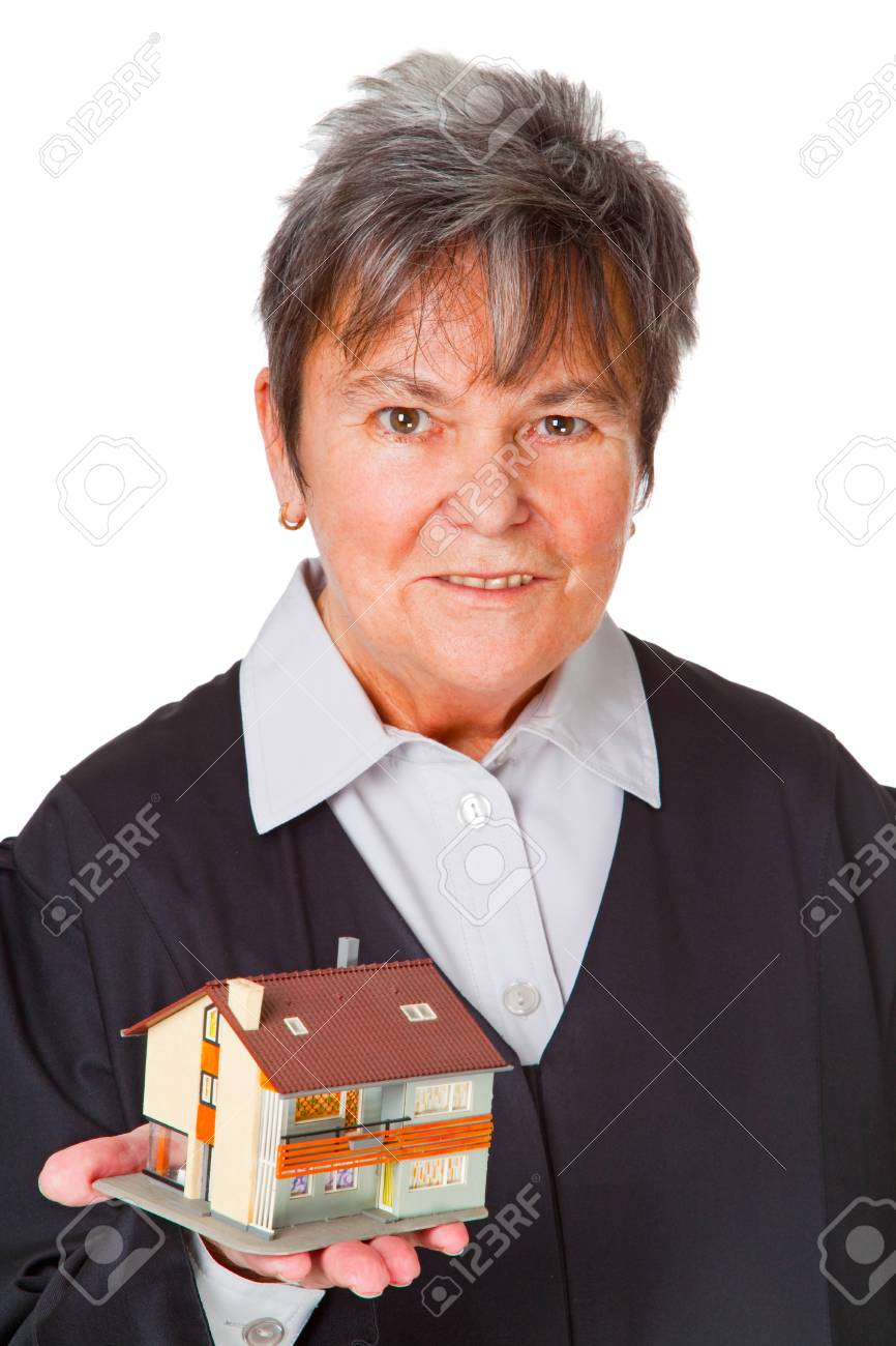 Female laywer with modell house - isolated on white background Stock Photo - 9254186