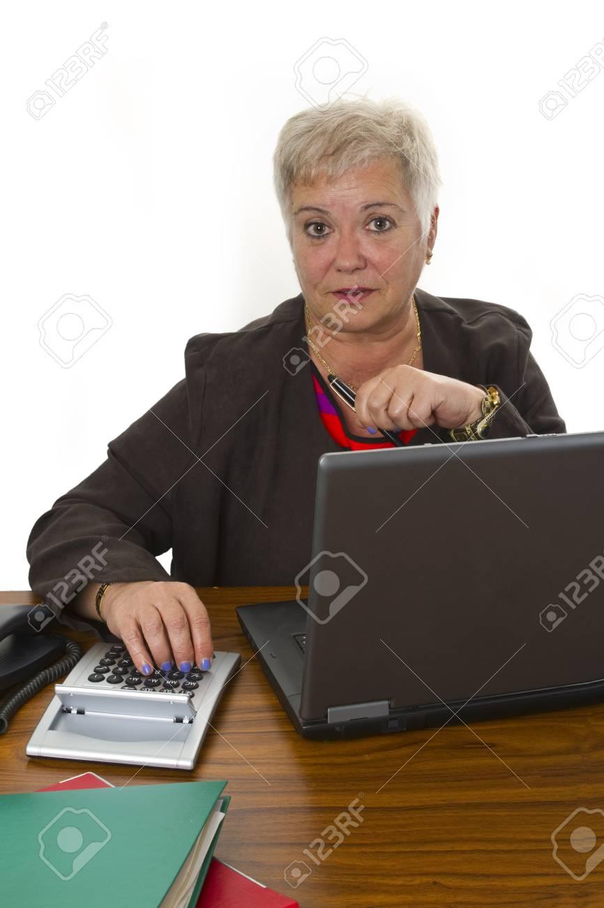 Female senior with laptop - isolated on white background Stock Photo - 15784381