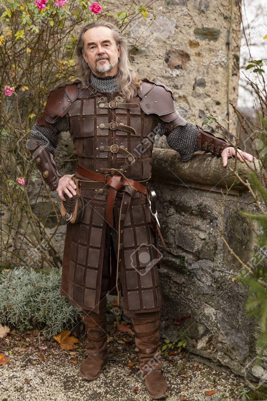 Posing impressive Knight in historic medieval cloth - 142741110