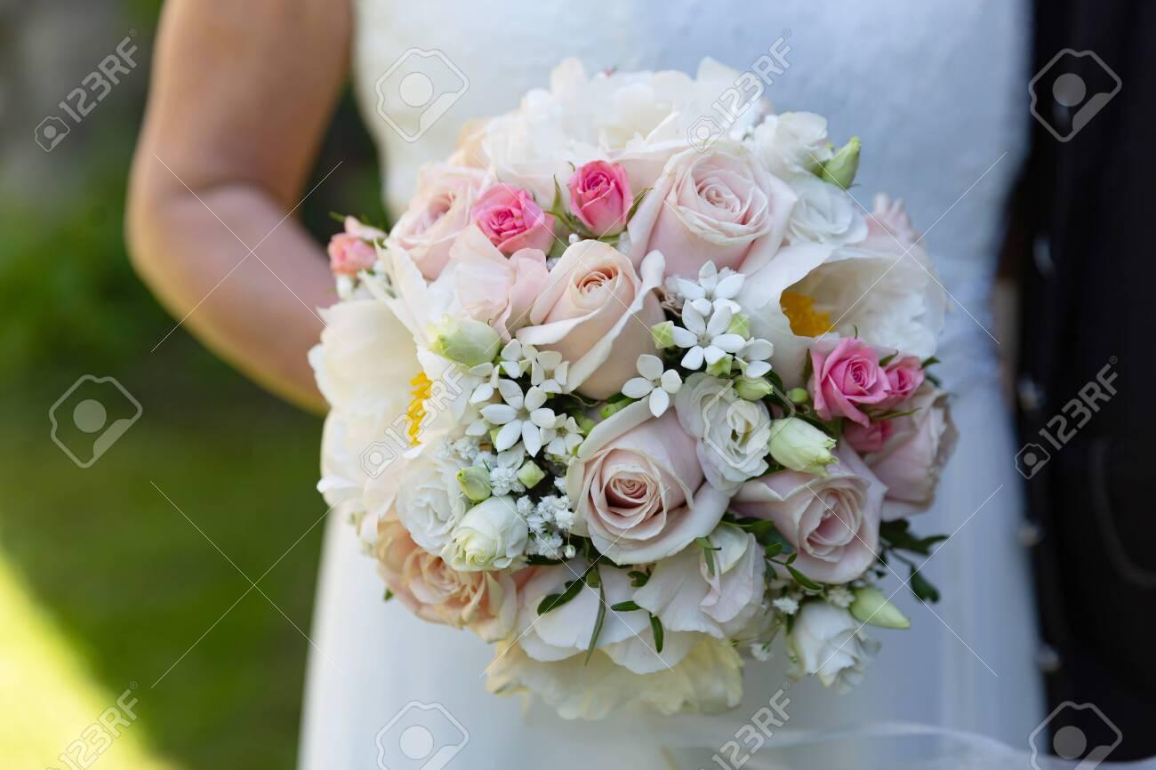 Bride Holding Blooming Flowers in Detail - 155977149