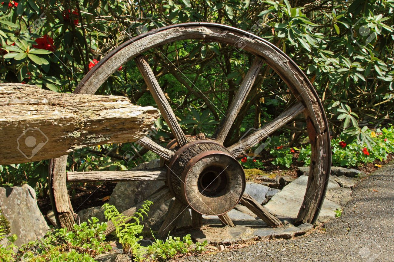 ... Old Wooden Wagon Wheel As Garden Ornament Stock Photo Picture And ...