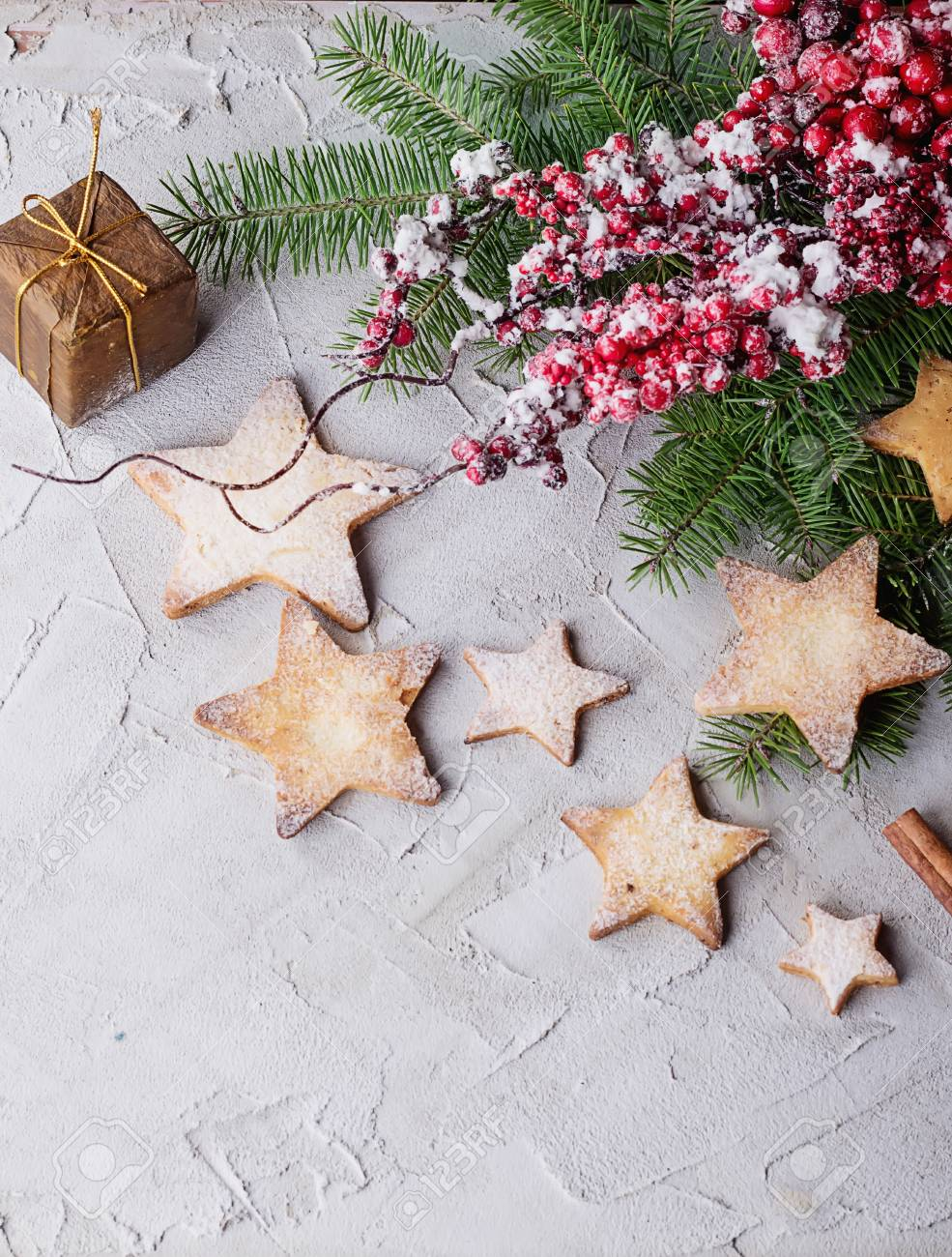 Freshly Cooked Christmas Star Cookies Over A Grey Background