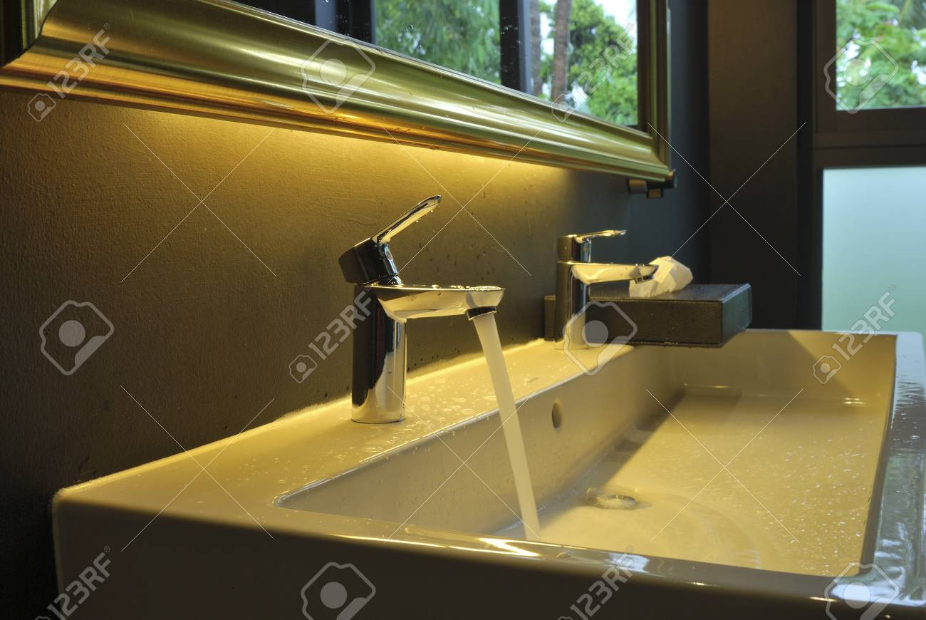 Running Water Out Of Modern Faucet Stock Photo, Picture And Royalty ...