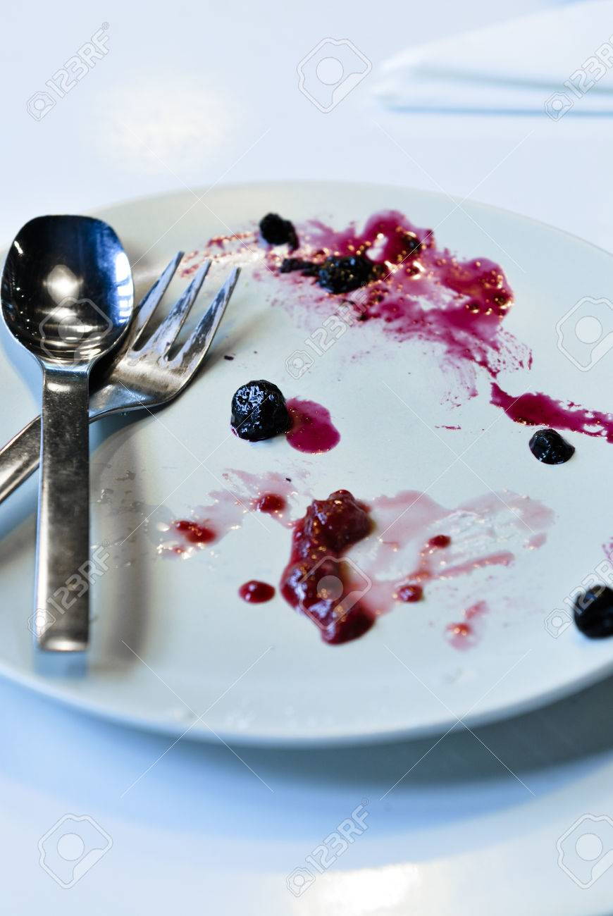 An empty plate, dirty after the meal is finished. - 28933264