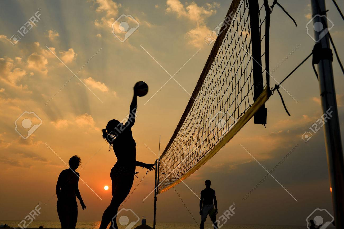 Beach volleyball silhouette at sunset , motion blurred - 40644195