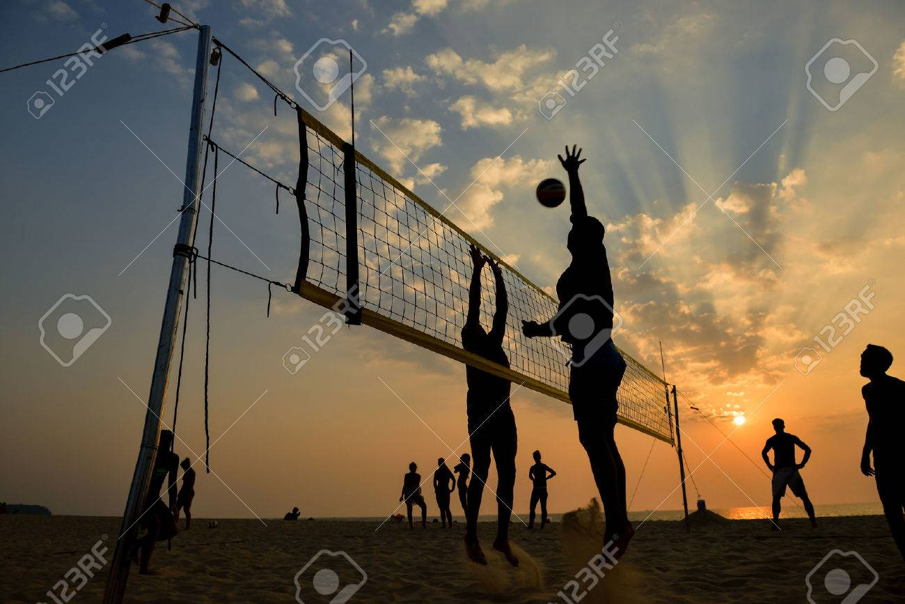 Beach volleyball silhouette at sunset , motion blurred - 40644543