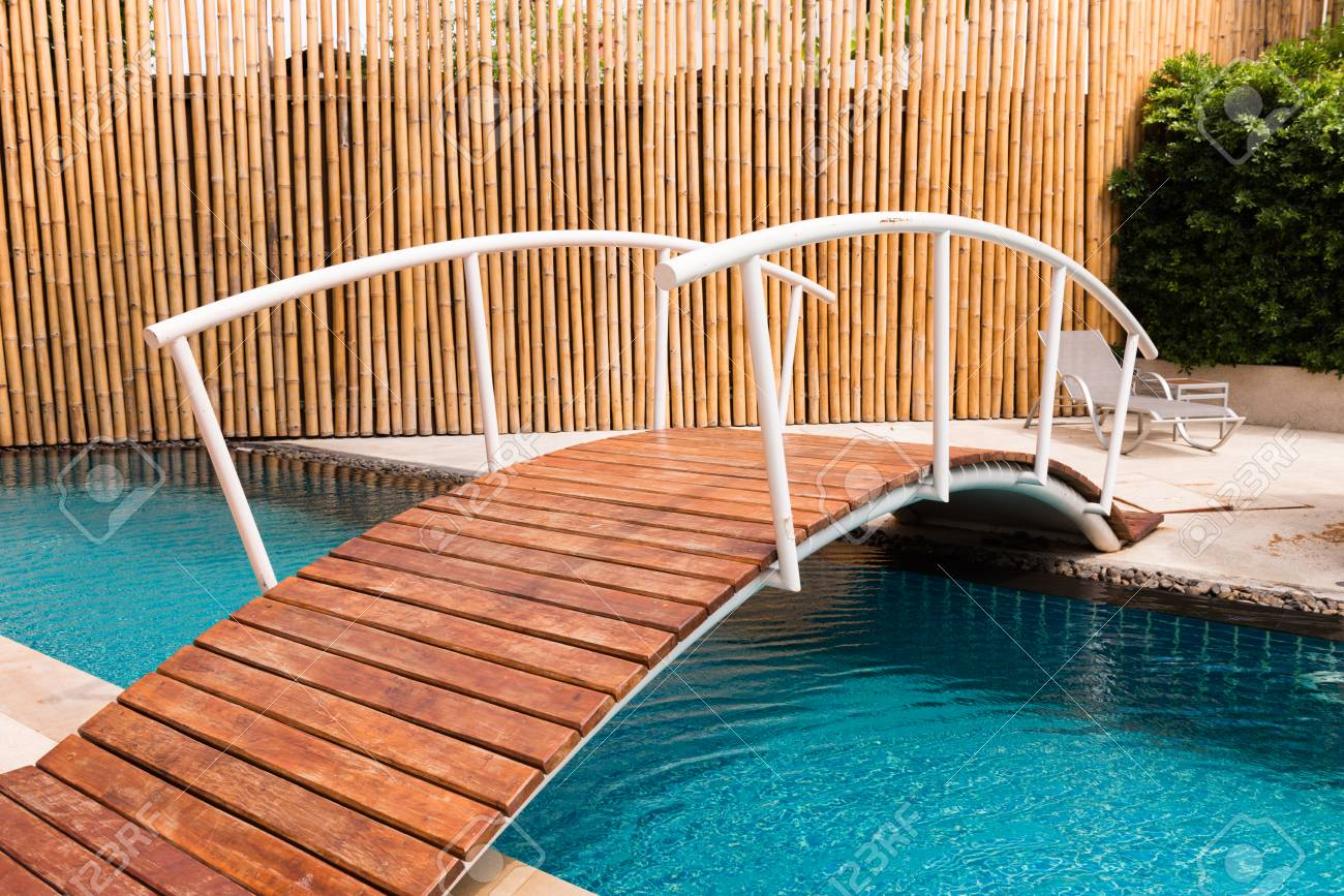 Bridge over the swimming pool in resort