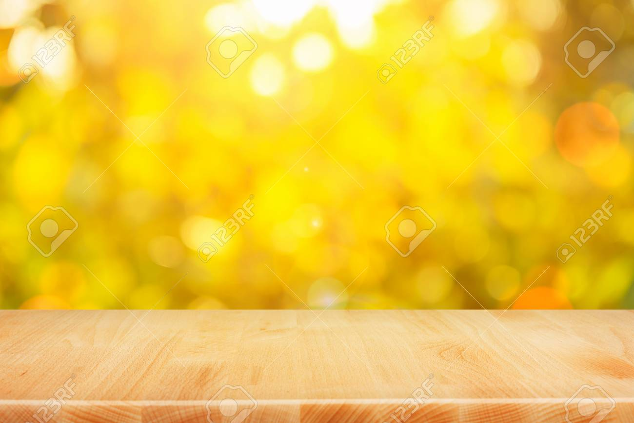 Wood table top on shiny bokeh gold background - can be used for display or montage your products - 55859545