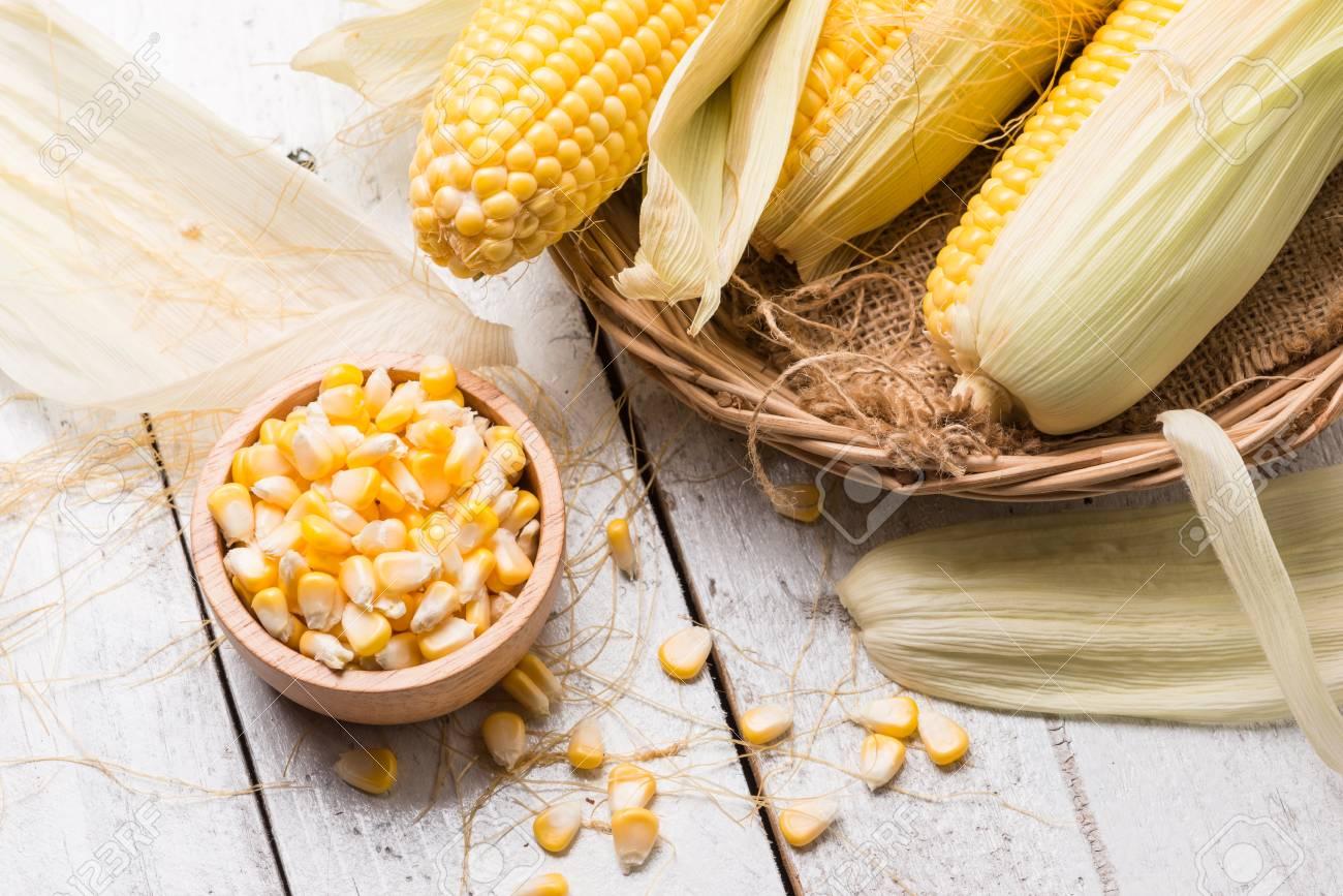 Fresh corn on rustic wooden table, closeup, Ear of corn - 81884245
