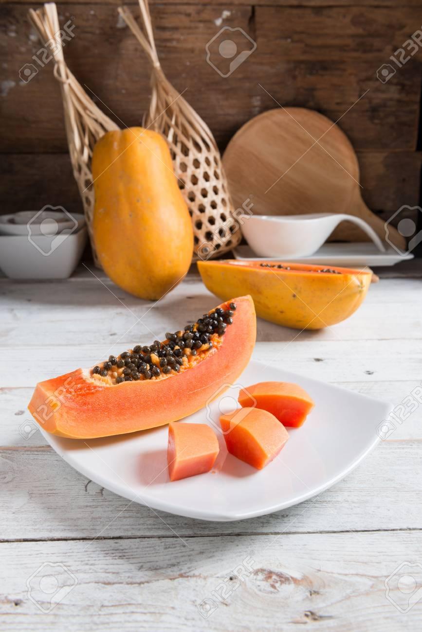 Papaya fruit on wooden background. - 87106203