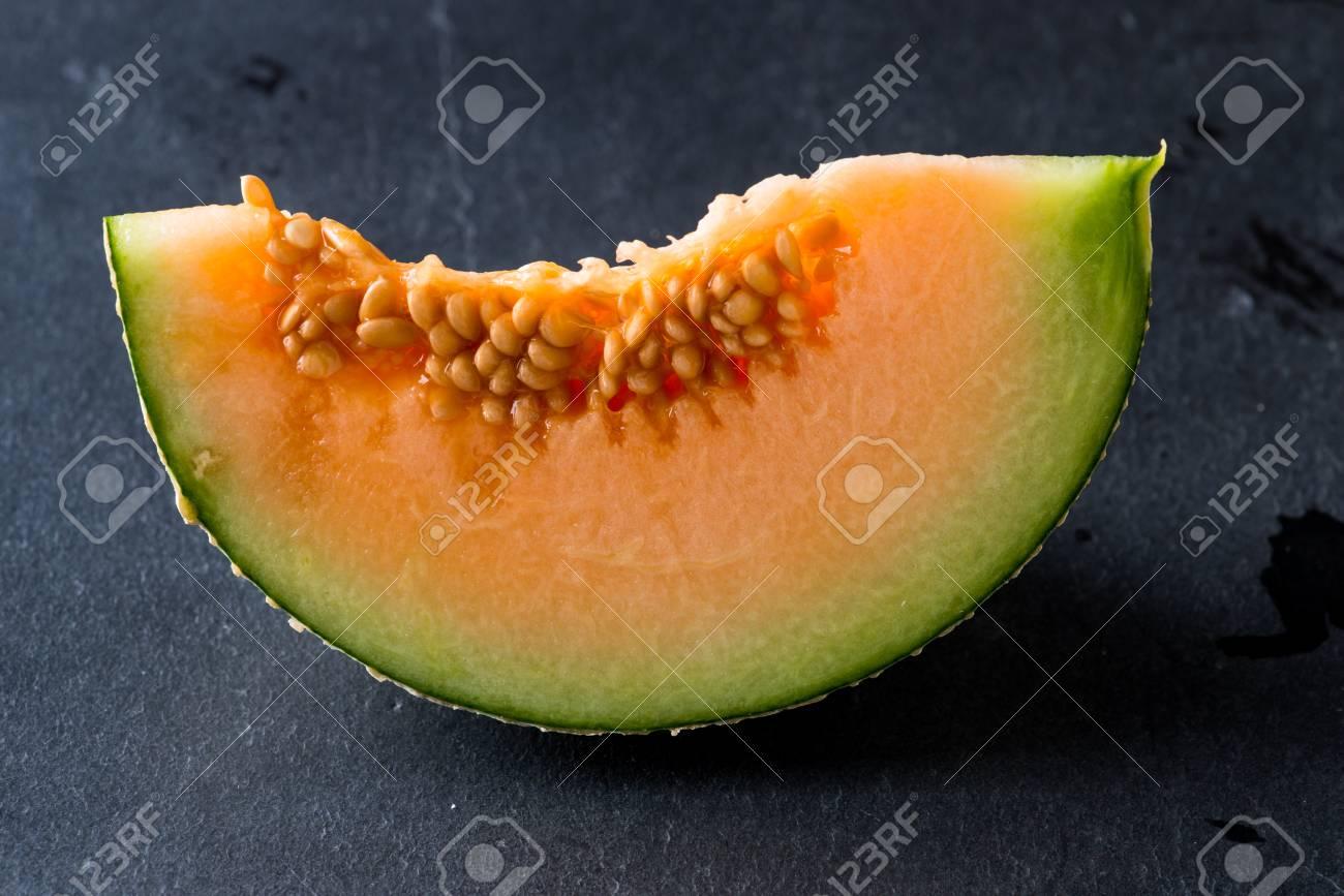 Melon slice on rock plate background - 93006873