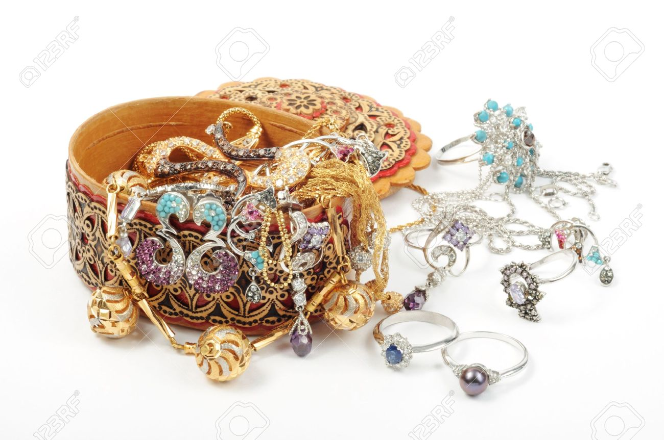 Open wooden jewelry box with accessory round it Stock Photo - 7532000