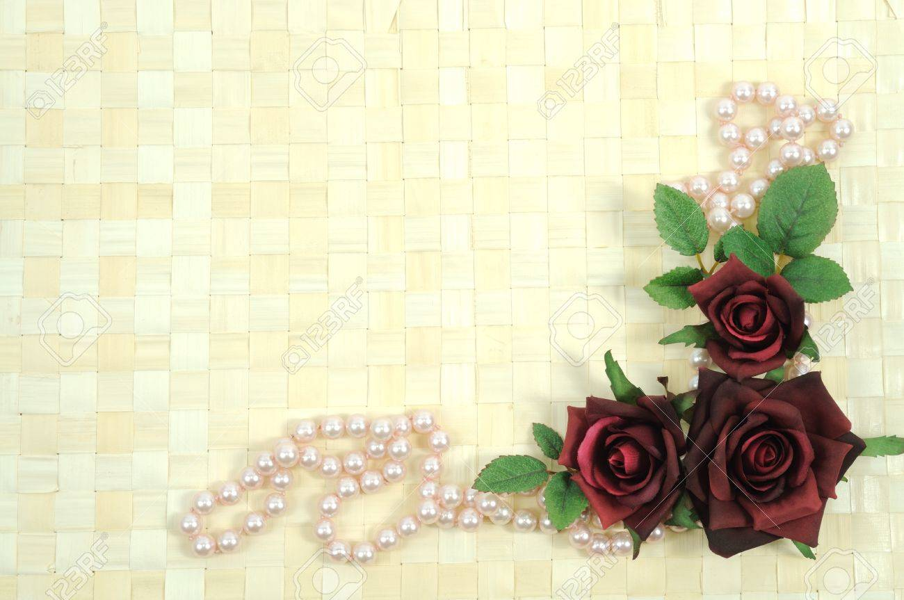 Framework on wooden background from roses and pearls Stock Photo - 8942284