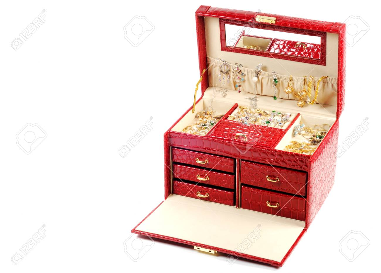 An open jewlery box with gold and platinum  jewelry inside  on a white background Stock Photo - 12184766