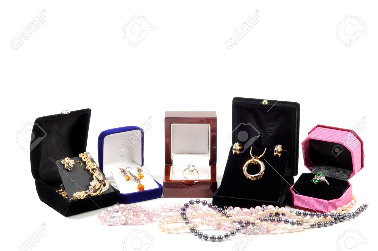 An open jewlery boxes with gold and platinum  jewelry sets on a white background Stock Photo - 12184756