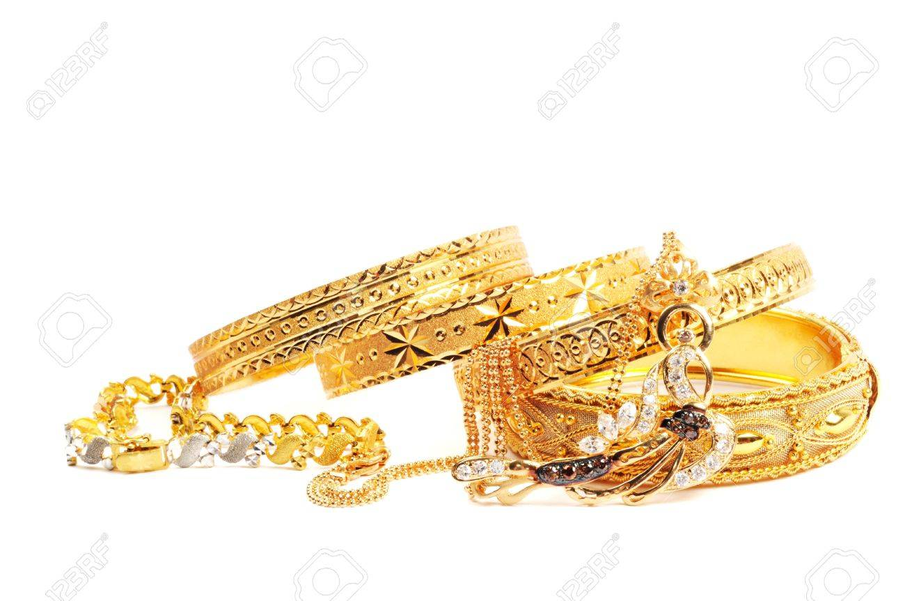Golden bracelets and necklace with diamonds, over white Stock Photo - 13338798