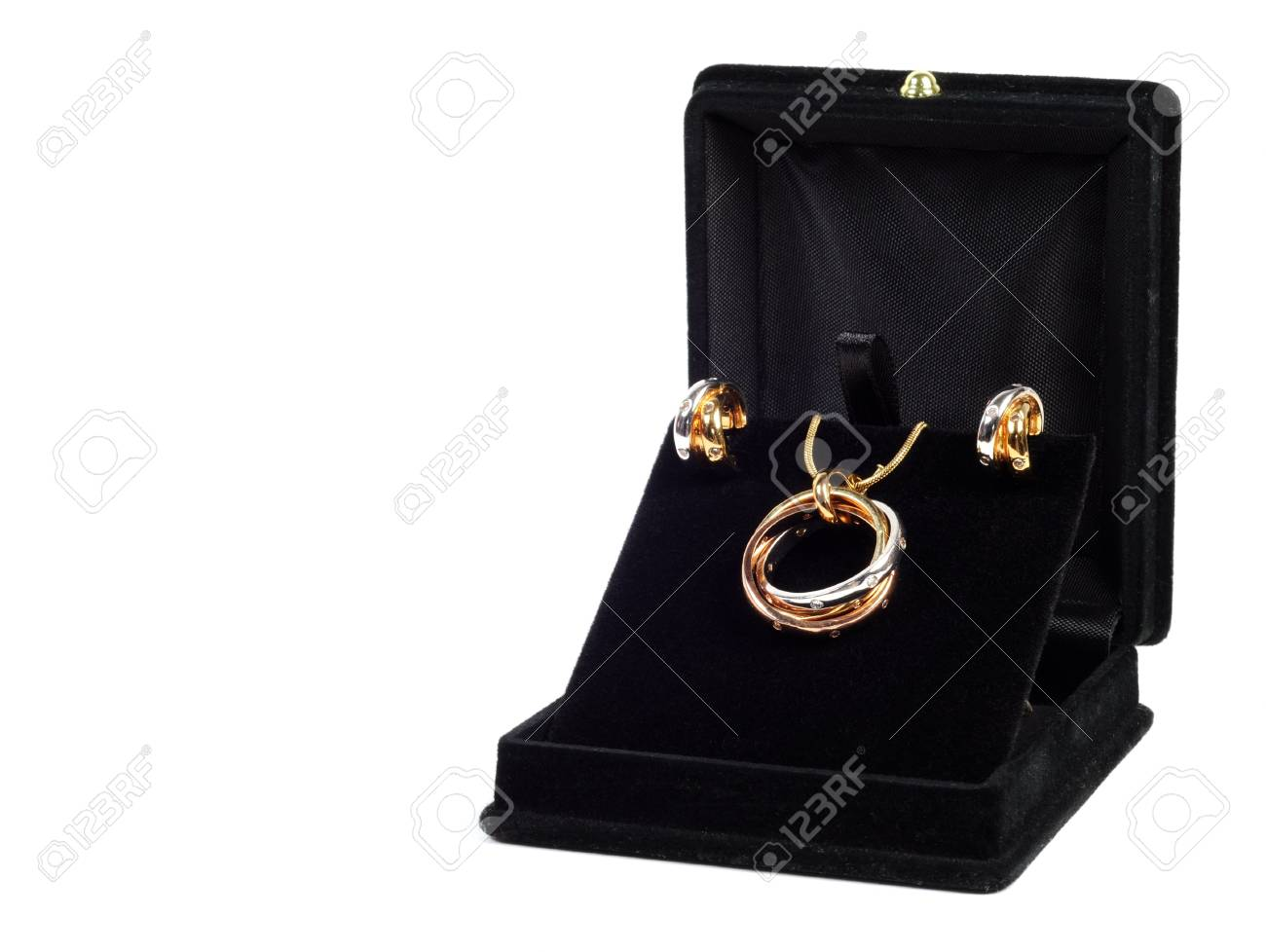 An open jewlery box with gold and platinum  jewelry set Stock Photo - 13582789