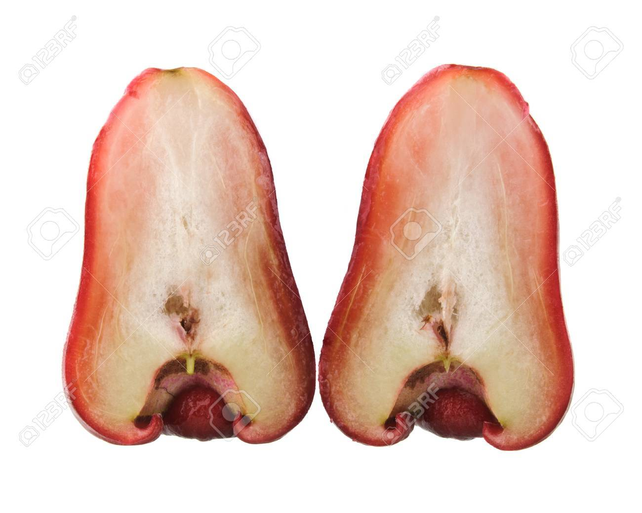 Red rose apple cut in half and isolated on white. Its scientific name is