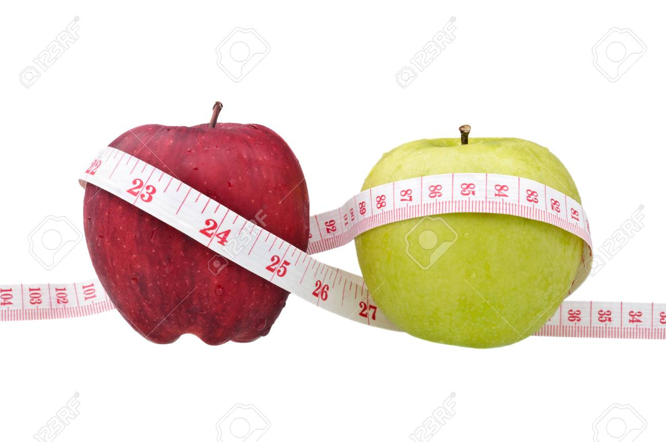 red and green apples with measure tape isolated on white Stock Photo - 9138012