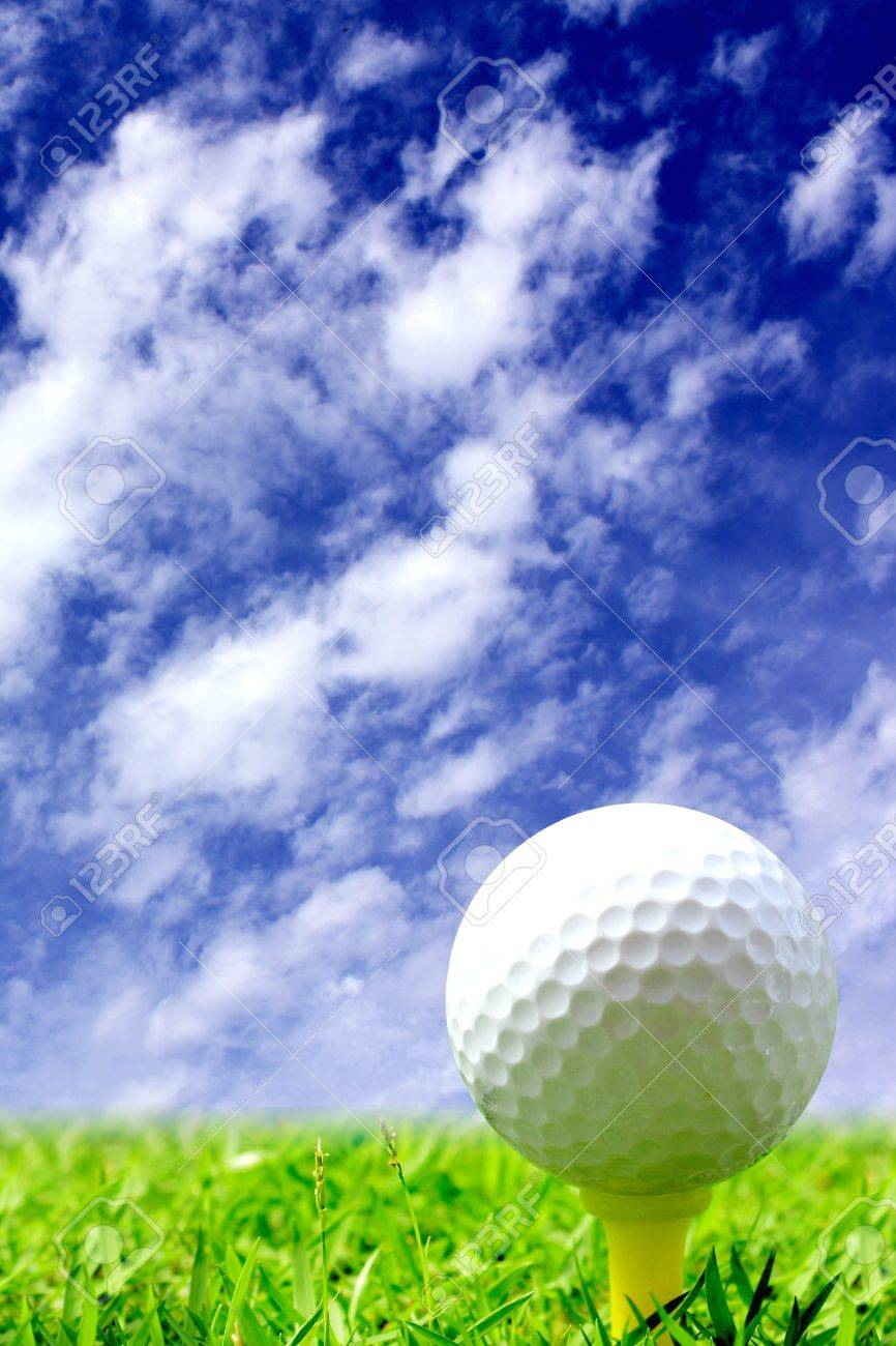 close up of a golf ball in the middle of the fairway stock photo