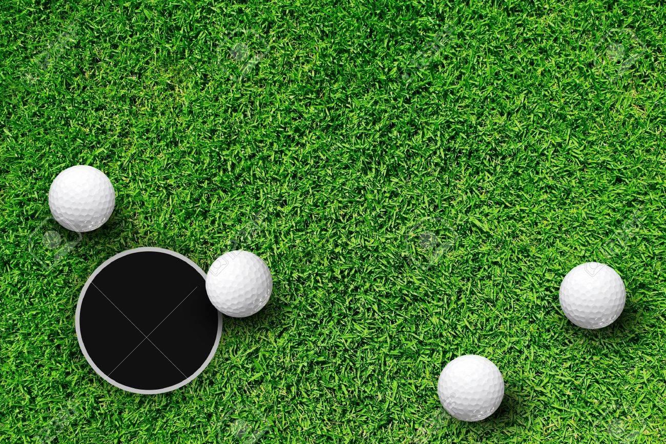 Golf Ball on Edge of Hole Stock Photo - 9840608