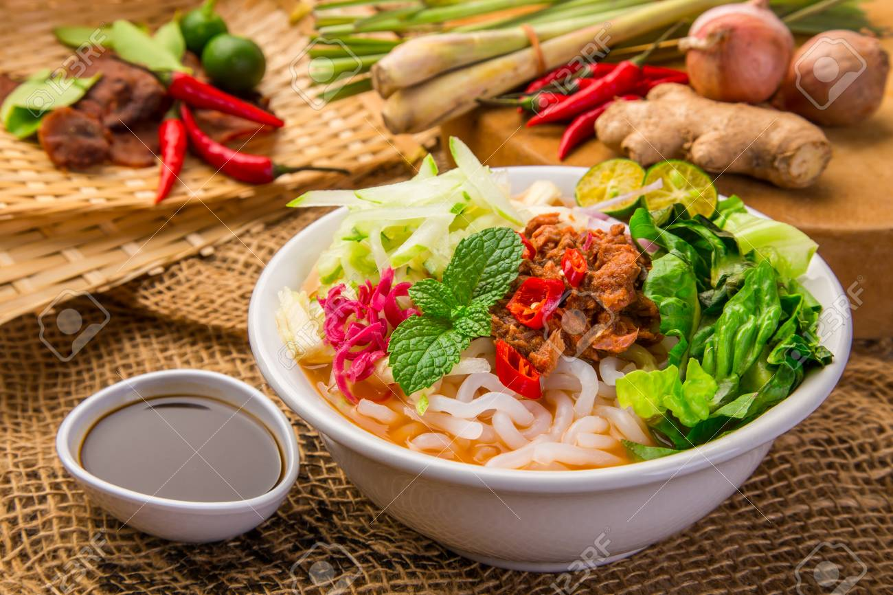 Assam Laksa (Noddle in Tangy Fish Gravy) is a Special Malaysian Food Popular in Penang - 85129344