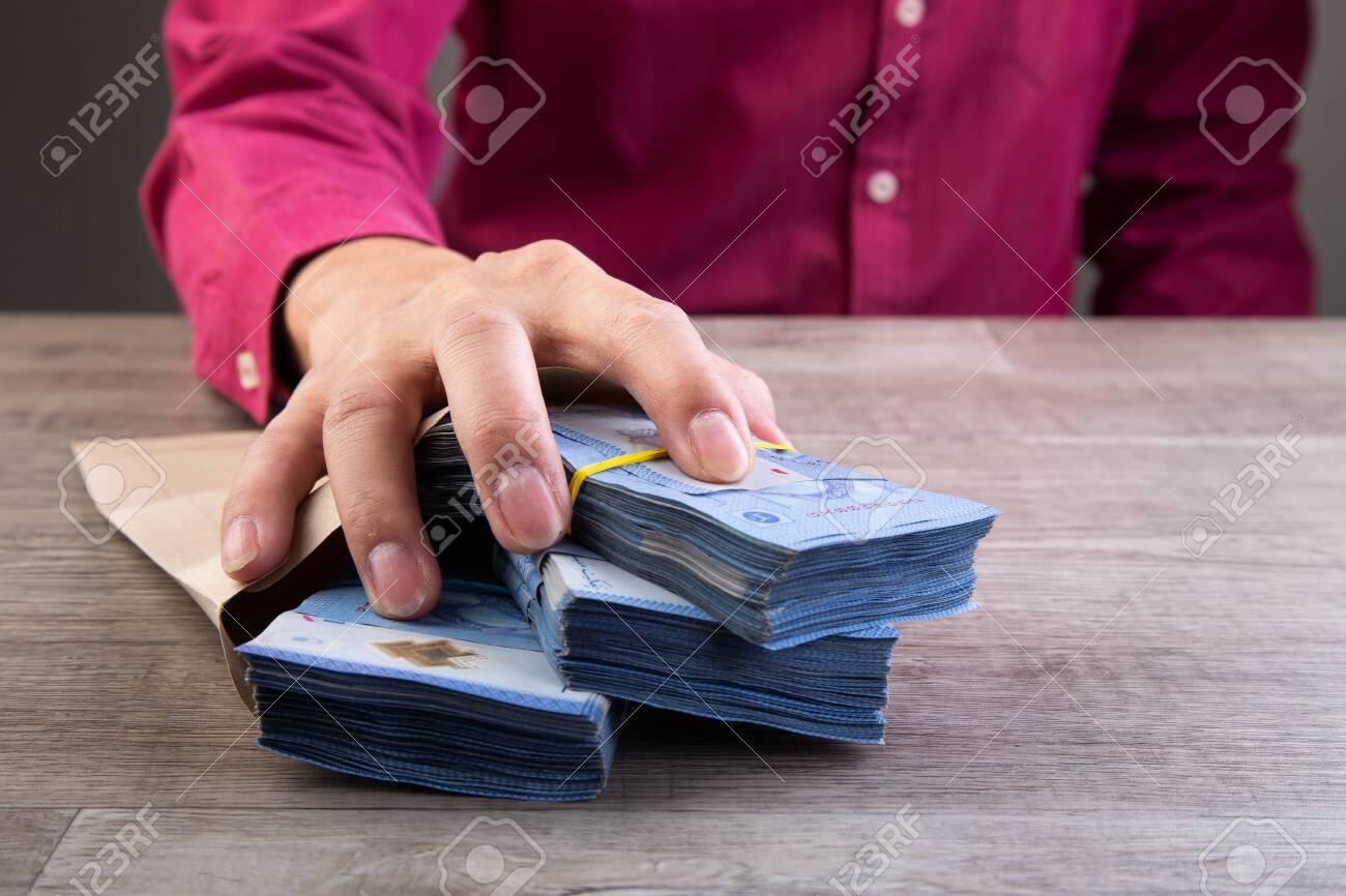 Businessman receive money in the envelope offered in file - anti bribery and corruption concepts - 150855981