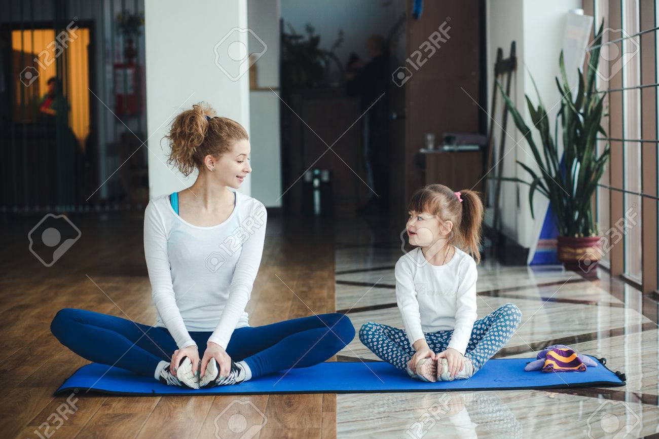 Two girls of different ages makeing yoga - 38373722