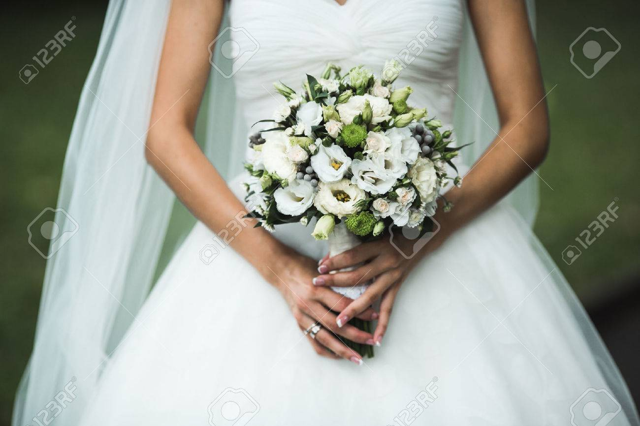 Very beautiful wedding bouquet in hands of the bride - 40605783