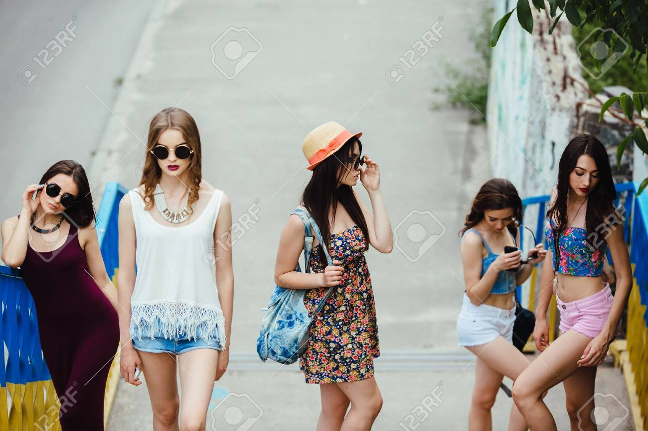 Five young beautiful girls walking and having fun in the city - 43070789