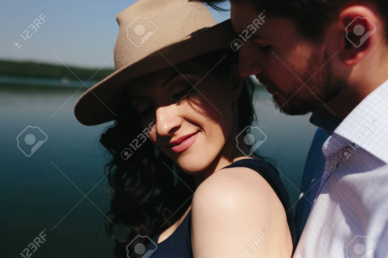 beautiful young couple spends time on the wooden pier on the lake - 43774116