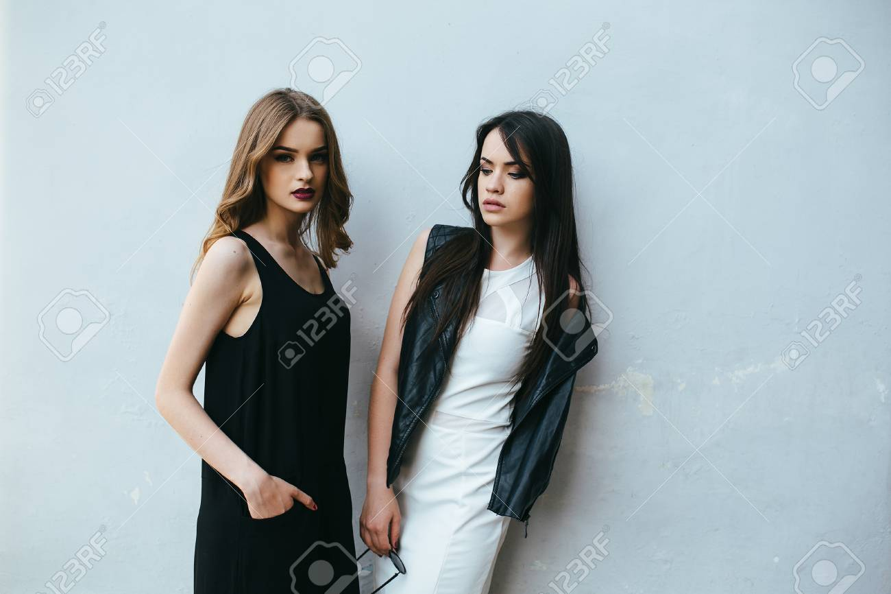 Two young and beautiful girl posing on a white background - 44418132