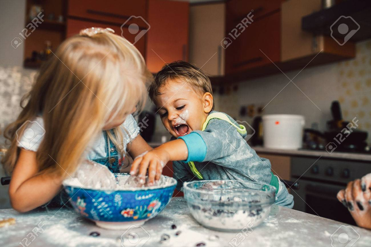 Kids is playing with flour in the kitchen - 45964897