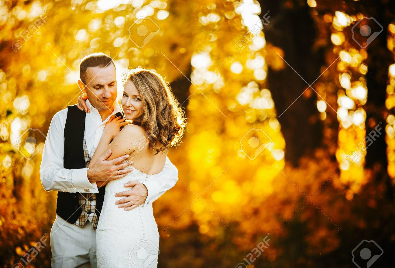 beautiful couple posing on a background autumn forest - 46332278