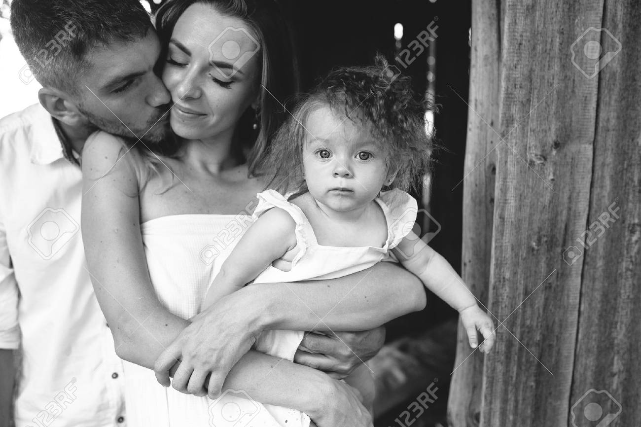 mother, father and daughter together having fun on the farm - 48556431