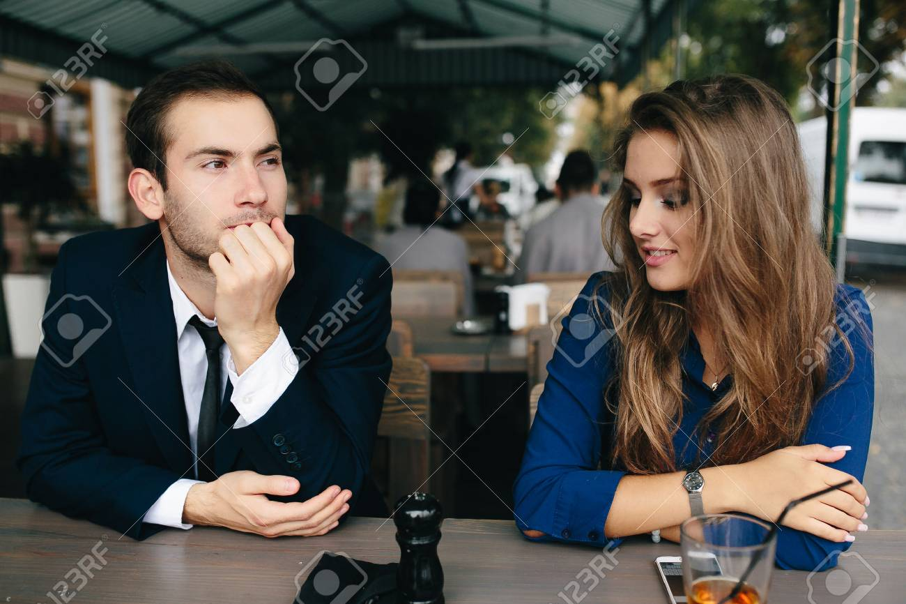 beautiful couple sitting in the cafe and having fun - 52237572