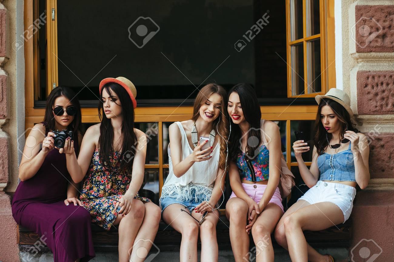 Five beautiful young girls relaxing in the city - 54492808