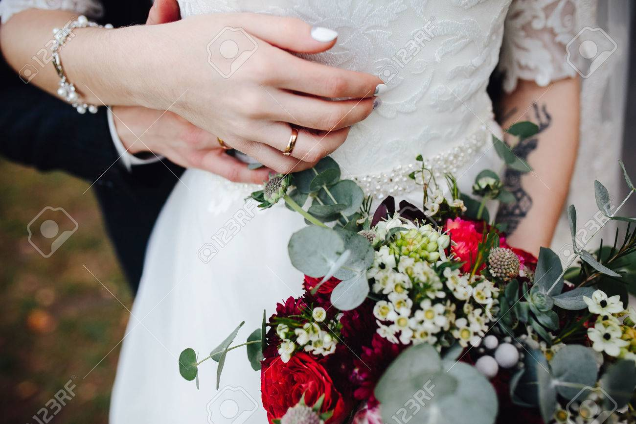 Bride holding wedding bouquet in her hands, close view - 63186316