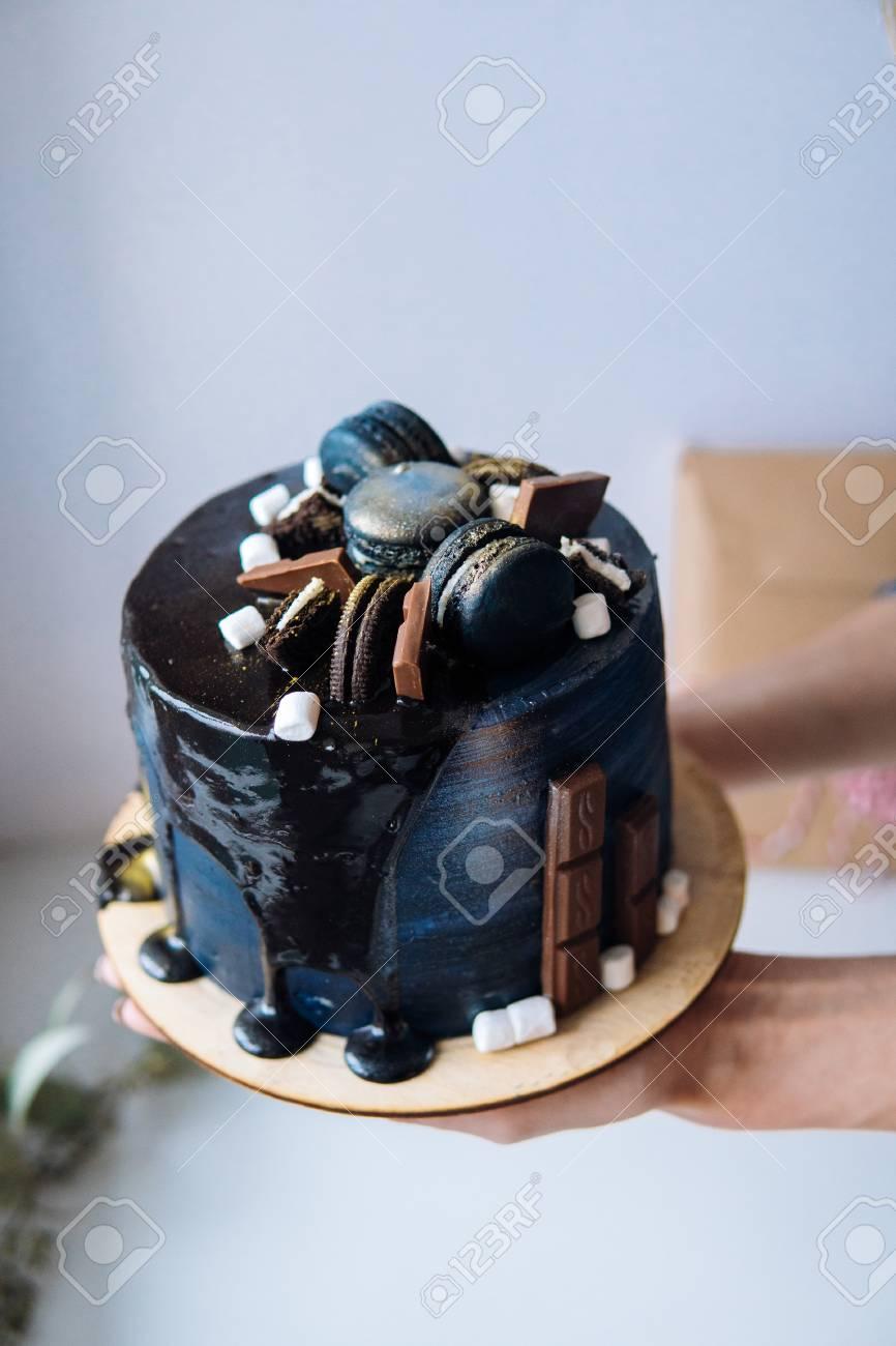 Beautiful Designer Chocolate Cake Someone Holds On Hands Stock Photo