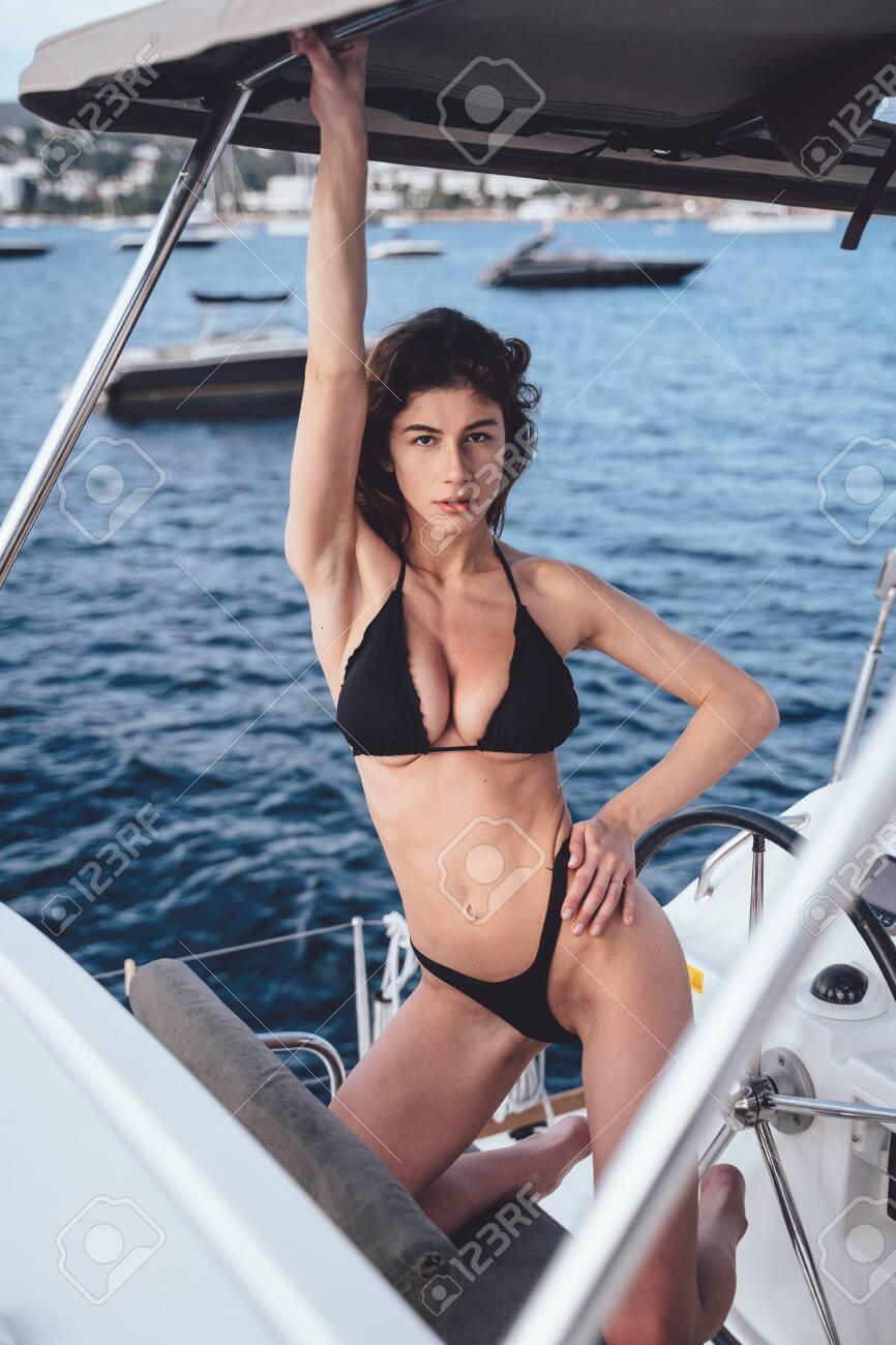 Fashion outdoor photo of beautiful young woman posing on a yachts - 130123243