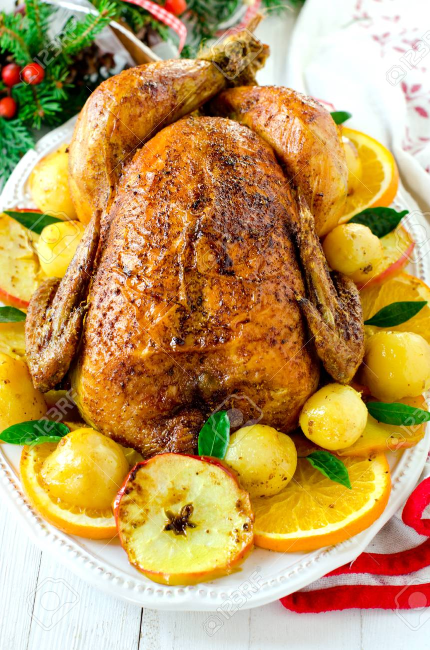 Christmas Baked Chicken Turkey With Oranges And Apples On A
