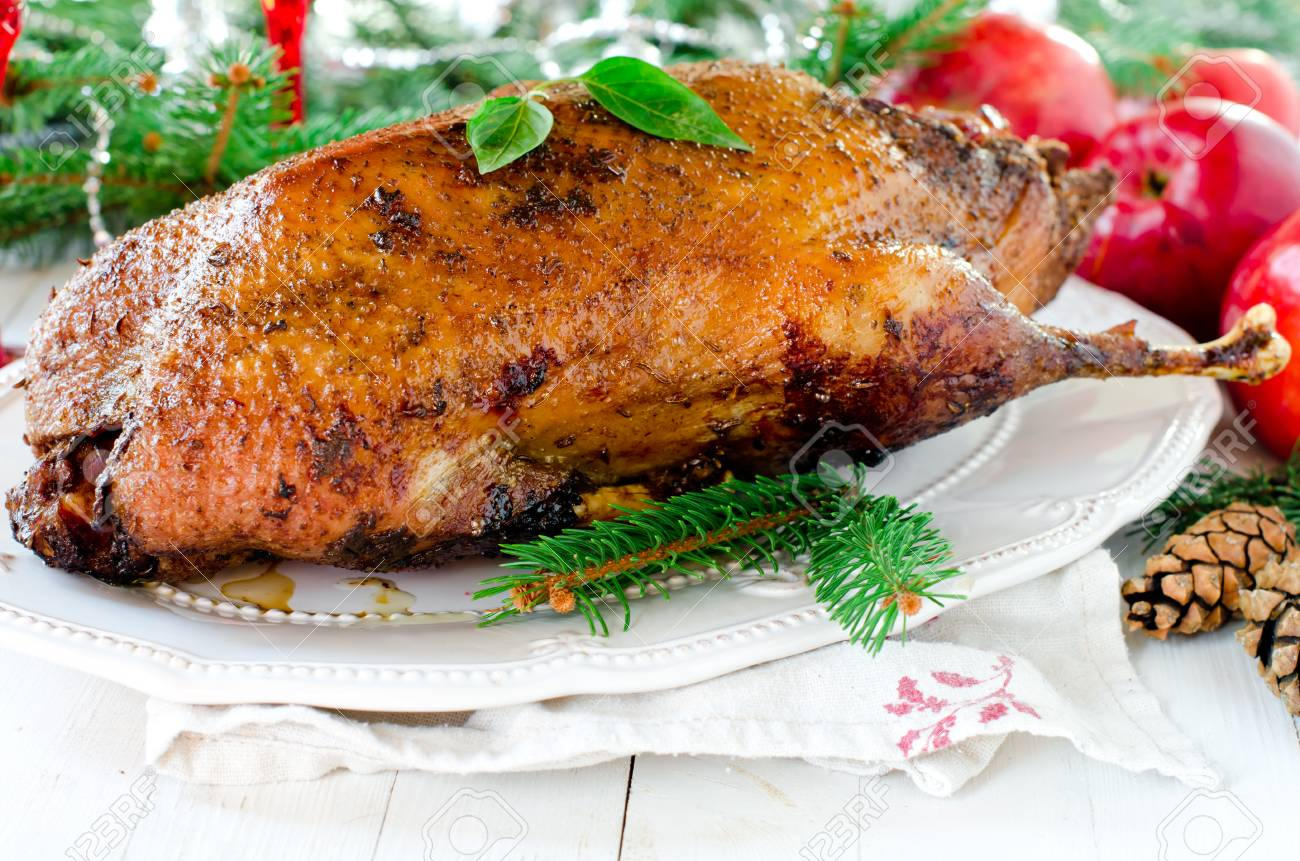 Christmas Duck Recipes.Christmas Duck Baked With Apples On A White Table With Christmas