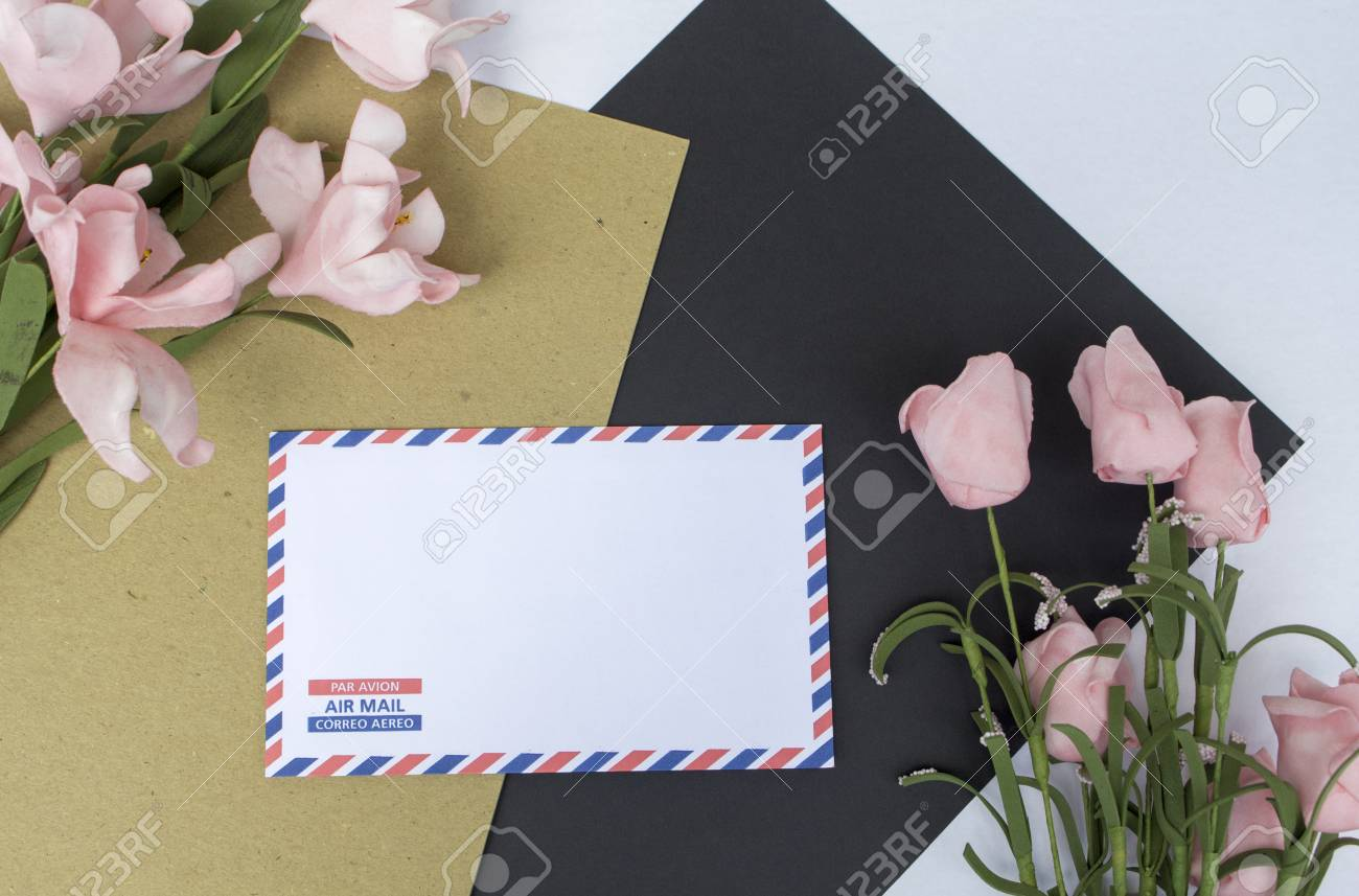 Composition With Letter Coral And Flower On White Background