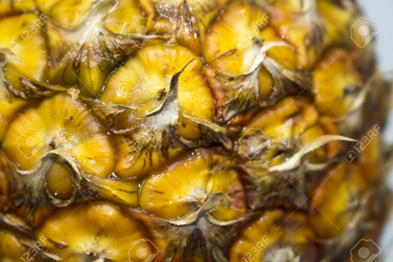 66817029 pineapple surface close up photo natural fruit skin wallpaper or background yellow pineapple skin ma