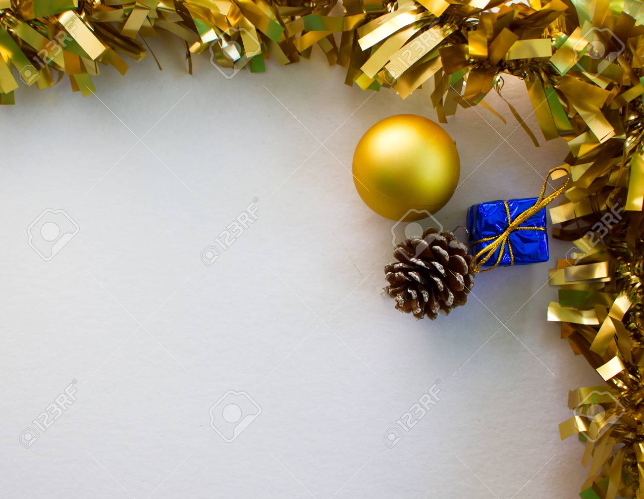 Gold Christmas Ornament Flat Composition On White Board Golden Ribbon Fir Tree Ball